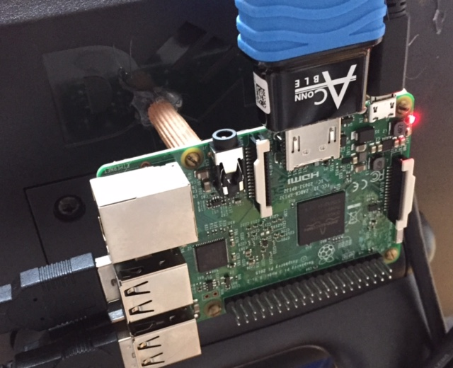 Hot glue holding on PI to back of the monitor with wooden dowels